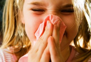 corbis_rf_photo_of_girl_blowing_nose