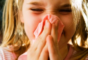 corbis_rf_photo_of_girl_blowing_nose